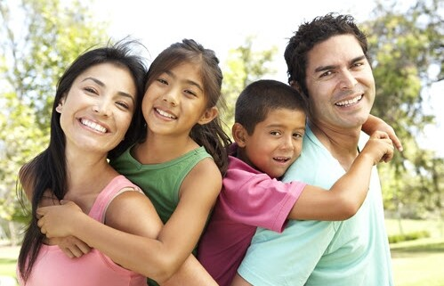 Hispanic Family With Beautiful Smiles