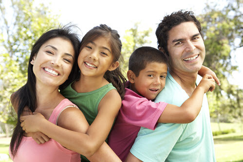 Hispanic Family With Beautiful Smiles